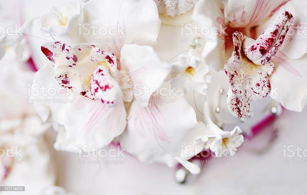 wedding cake decorated with creamy flowers royalty-free stock photo