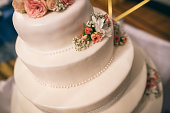 Layered wedding cake on the table
