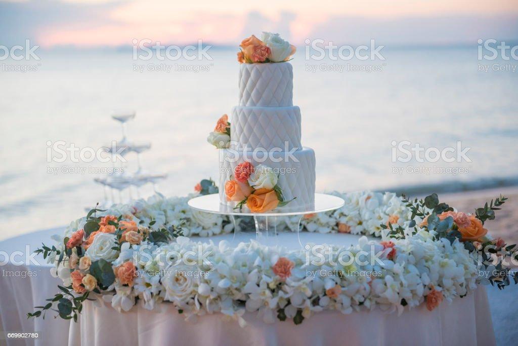 wedding cake in beach wedding stock photo
