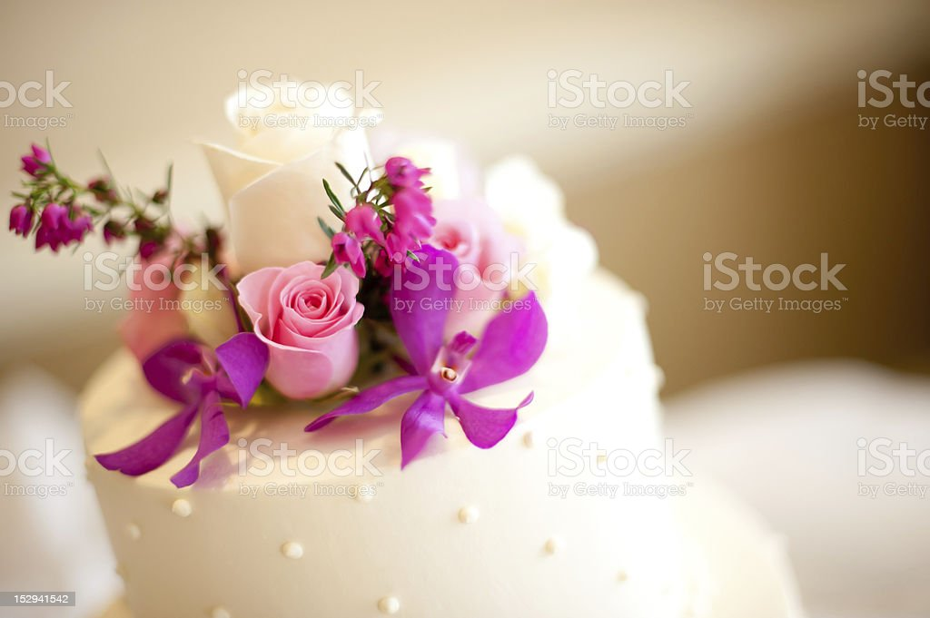 Wedding Cake Layered three tier roses and orchid flowers royalty-free stock photo