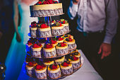 Layered wedding cake on the table with berry fruits