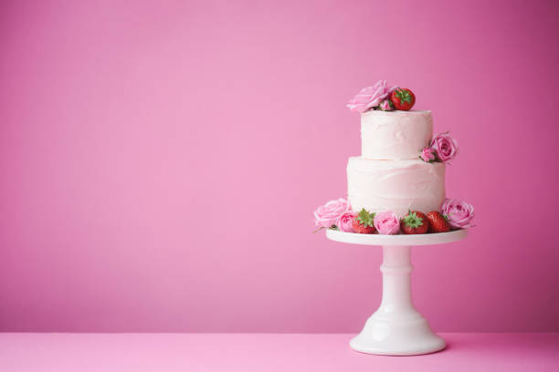 Wedding cake Cake decorated with fresh fruit and flowers cakestand stock pictures, royalty-free photos & images
