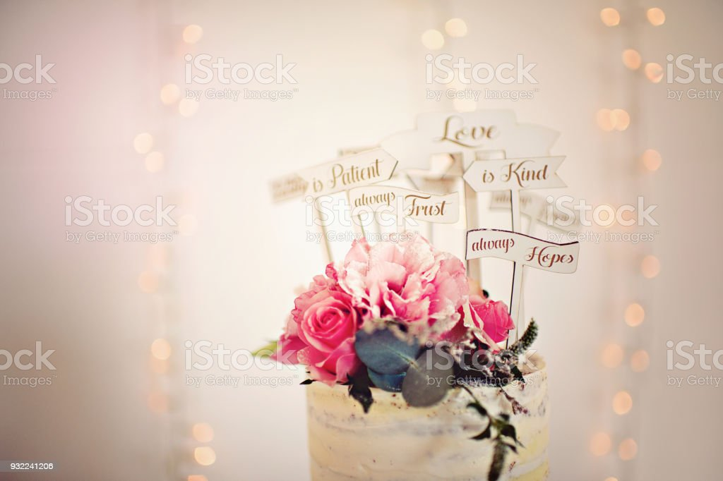 Wedding Cake Rose Topping with Bible Verse on Love stock photo