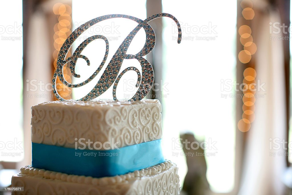 Wedding Cake topped with a jeweled letter royalty-free stock photo