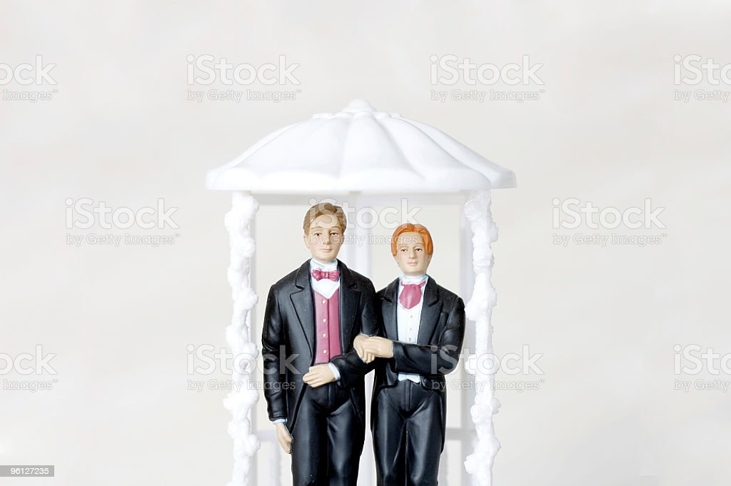 Wedding cake topper for gay wedding stock photo