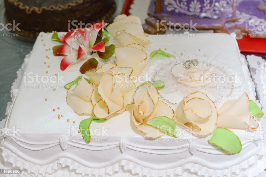 Wedding Cake Whit Rings And Flower Stock Photo & More Pictures of ...