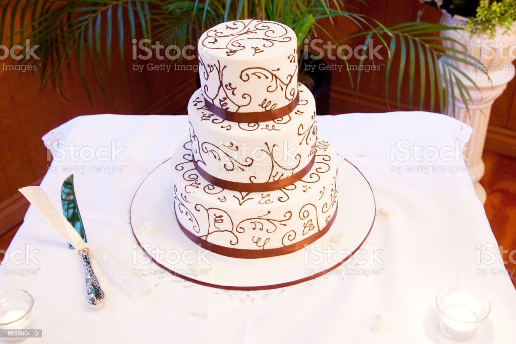Wedding Cake With Icing Decorations And Ribbons Stock Photo More