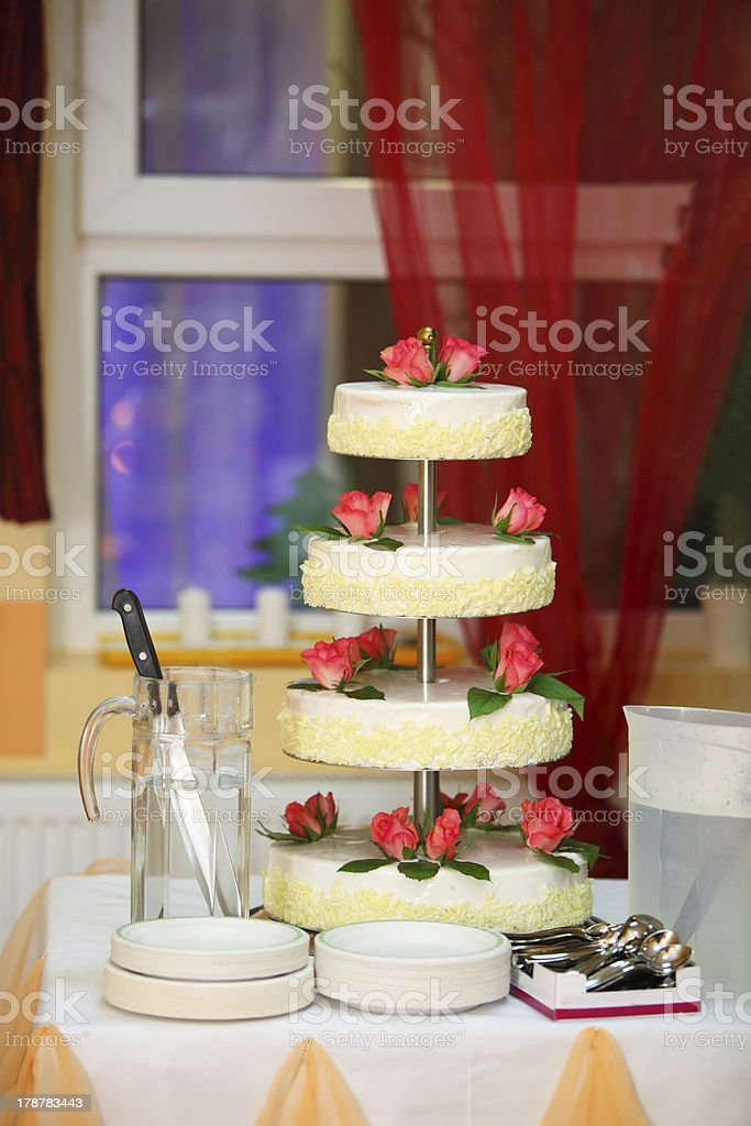 Wedding cake with red roses royalty-free stock photo