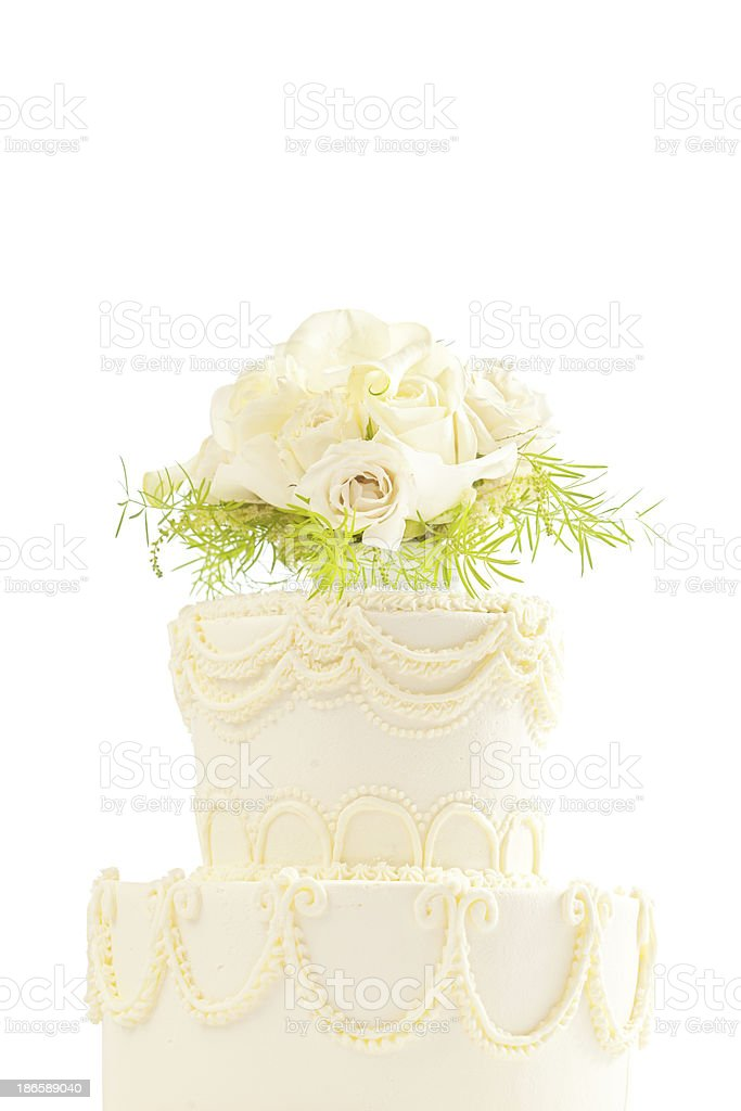 Wedding Cake with Rose Bouquet Topper on White Background royalty-free stock photo
