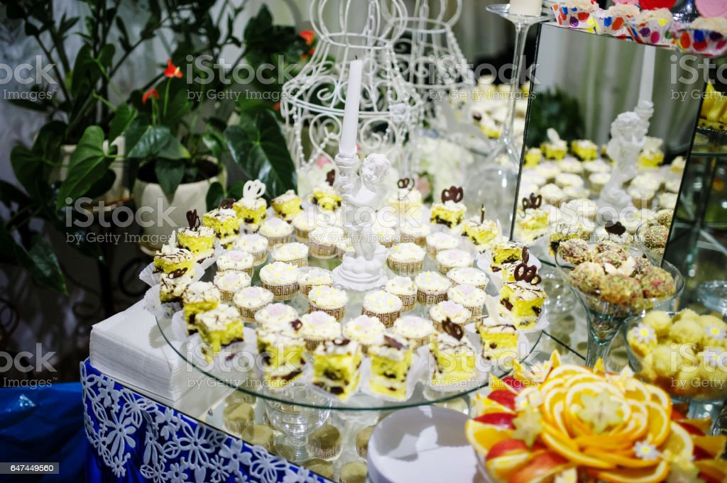 Wedding Cakes And Fruits With Figurine Of Angel Candlestick On