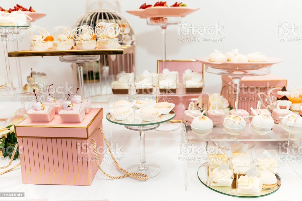 Wedding candy bar decoration setup with delicious cakes and sweets. royalty-free stock photo