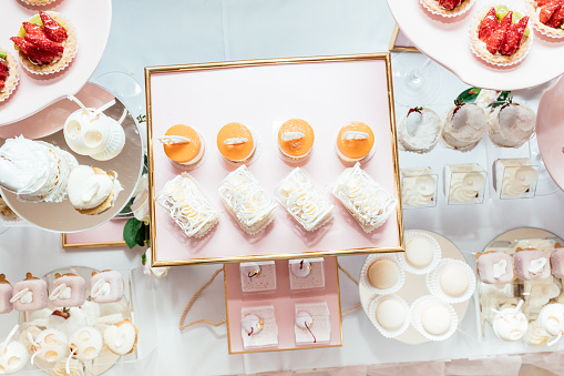 Wedding Candy Bar Decoration Setup With Delicious Cakes And Sweets Stock Photo - Download Image Now