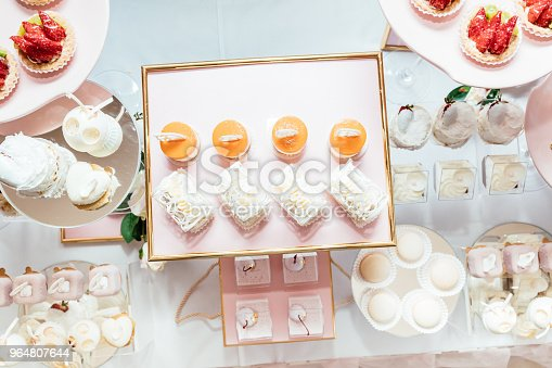 Wedding Candy Bar Decoration Setup With Delicious Cakes And Sweets Stock Photo & More Pictures of Baked