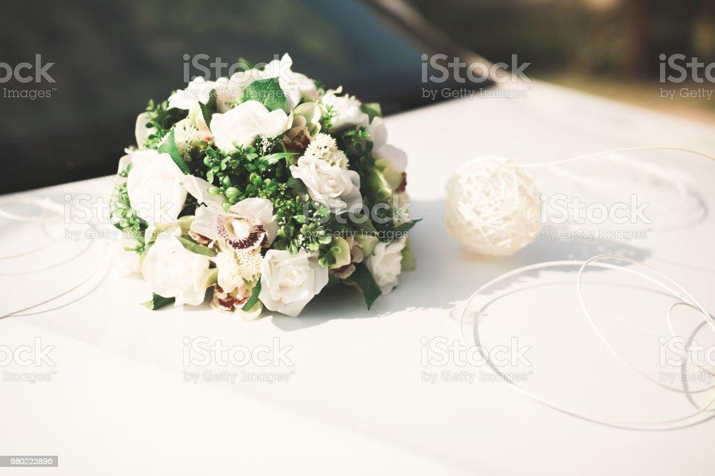 Wedding car decorated with beautiful, luxury flowers stock photo