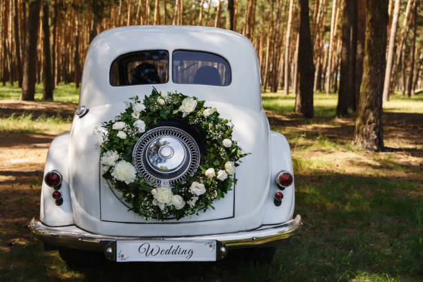 """Wedding car with a decoration in the form of a wreath and the word """"Wedding"""" stock photo"""