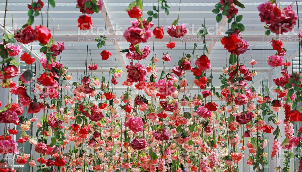 Wedding ceremony decoration with many artificial flower hanging from...