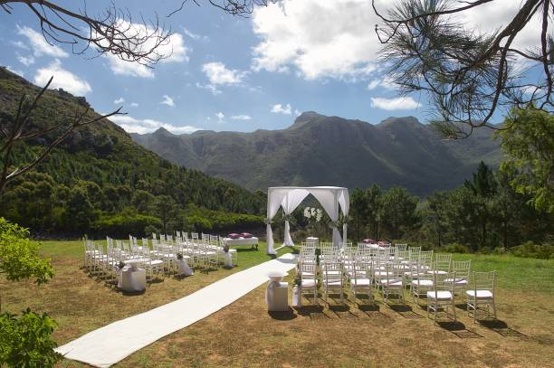 wedding ceremony setting between the mountains side view - entertainment building stock pictures, royalty-free photos & images