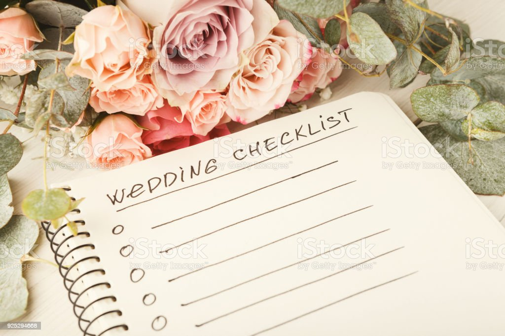 Wedding checklist and rose bouquet stock photo