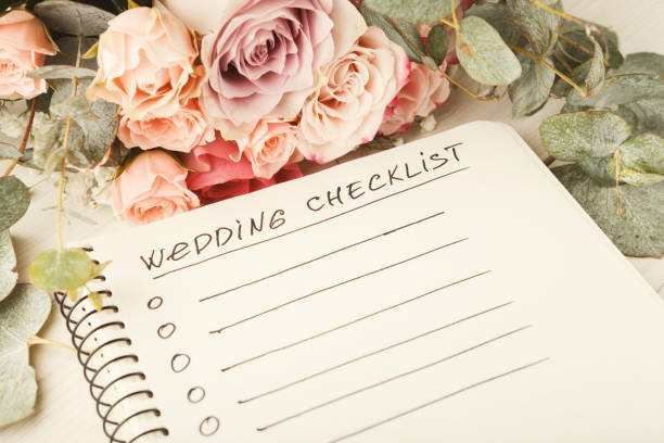 wedding checklist and rose bouquet - wedding stock photos and pictures