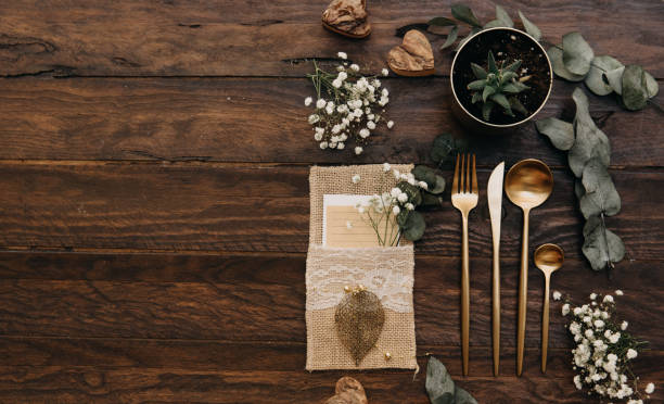 Wedding concept. Rustic table set over wooden background. Boho style, top view, flat lay stock photo