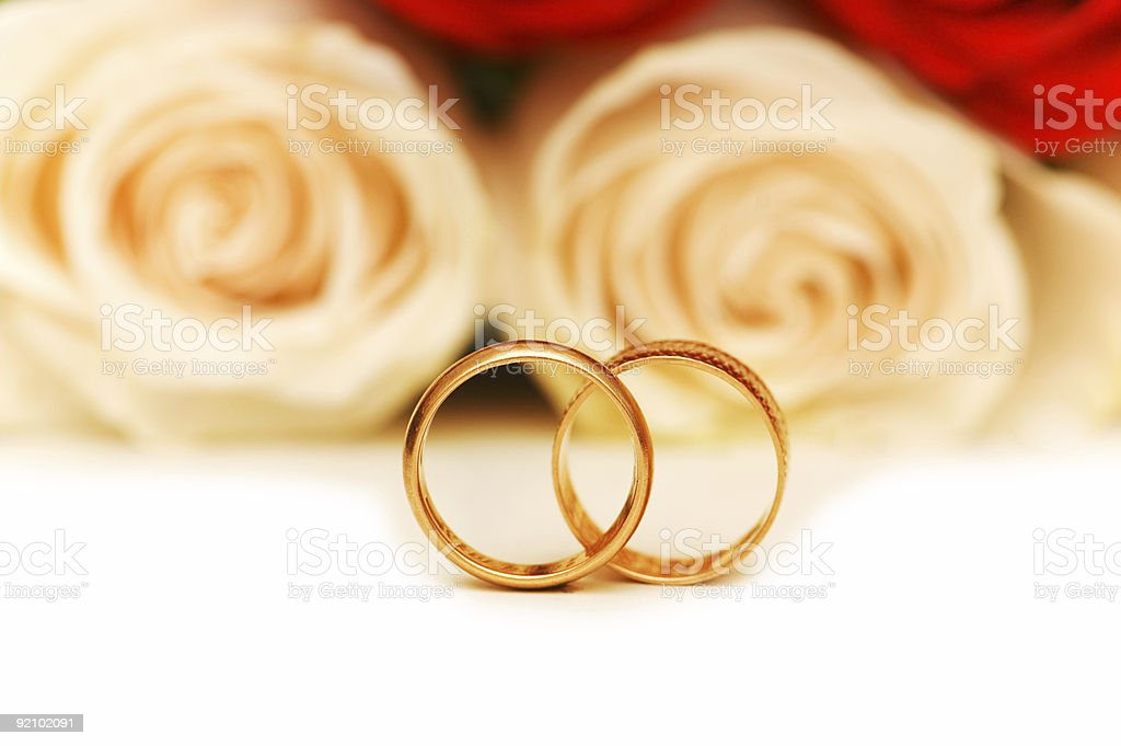Wedding concept with roses and golden rings royalty-free stock photo