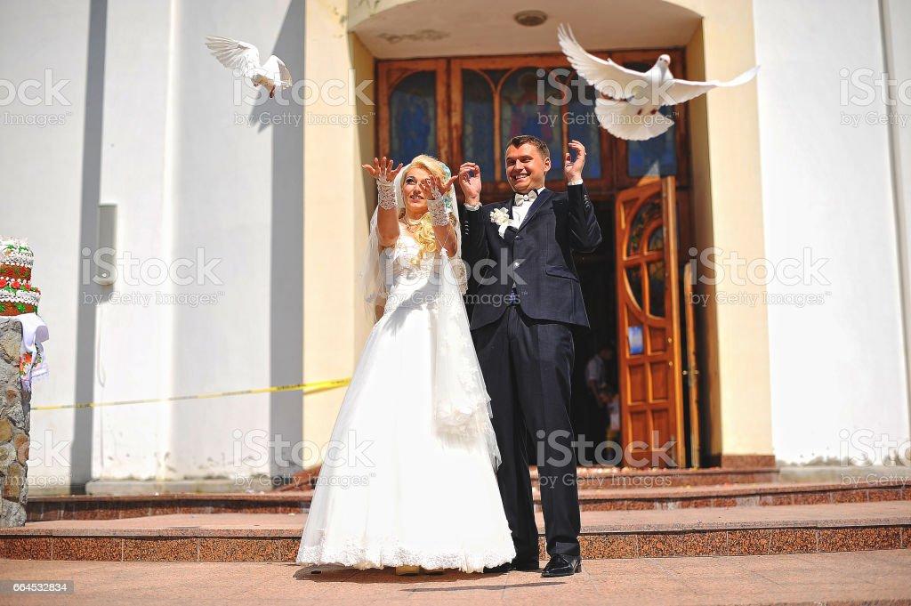 Wedding couple at catholic church royalty-free stock photo