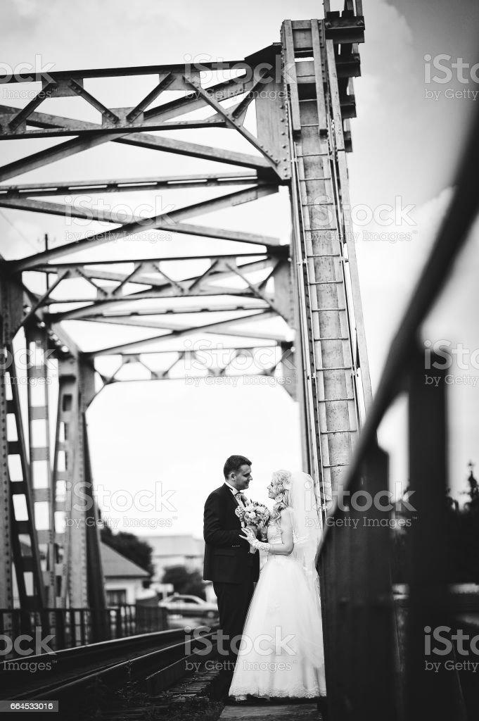 Wedding couple at train bridge royalty-free stock photo