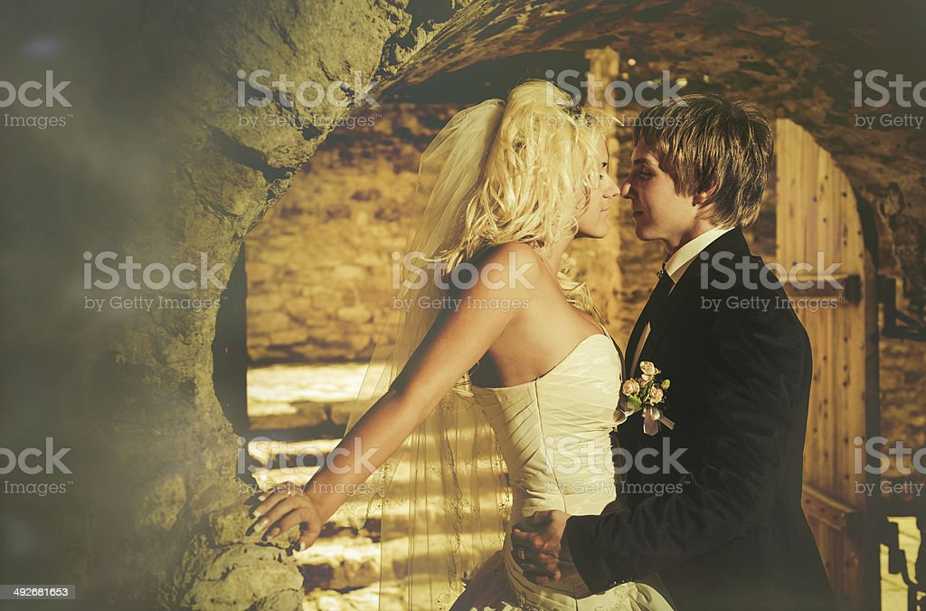 wedding couple at vintage entrance royalty-free stock photo
