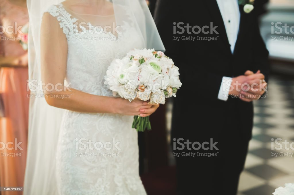 Wedding couple bide and groom get married in a church stock photo