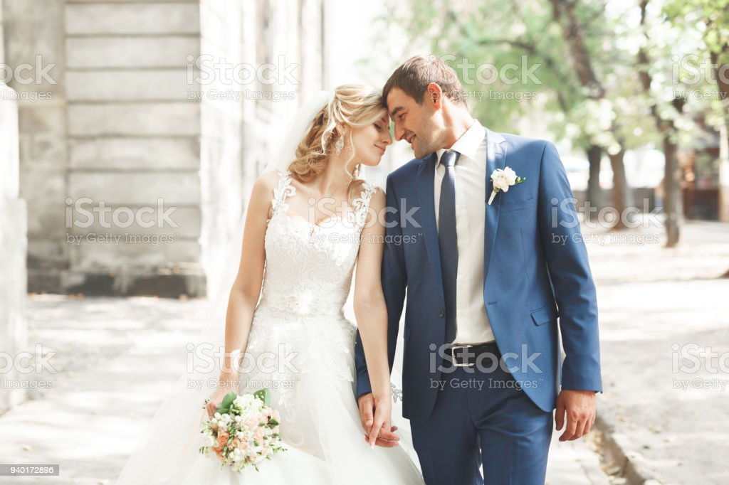 Wedding couple bride and groom holding hands stock photo