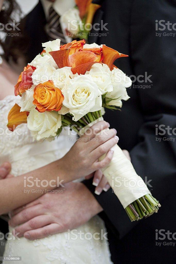 Wedding Couple Embrace, Bride Holding Beautiful Rose Bouquet royalty-free stock photo