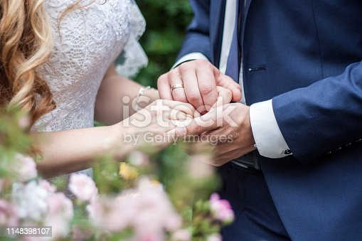 wedding couple holding hands, happy groom and bride. concept of love and marriage .