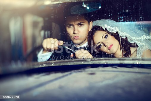 istock wedding couple in car 483677975