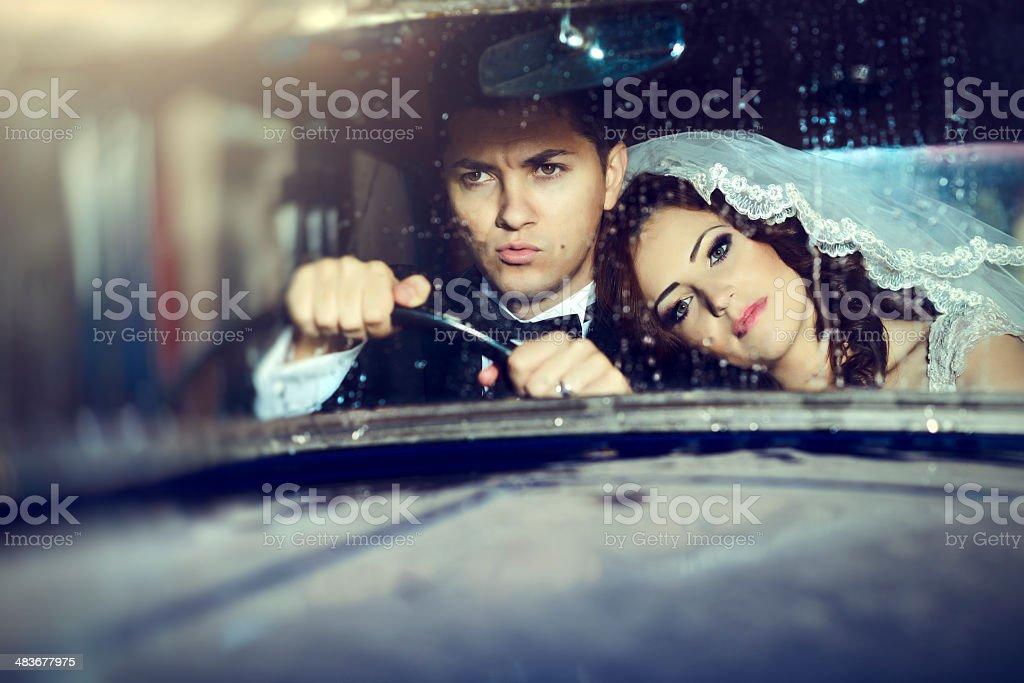 wedding couple in car stock photo