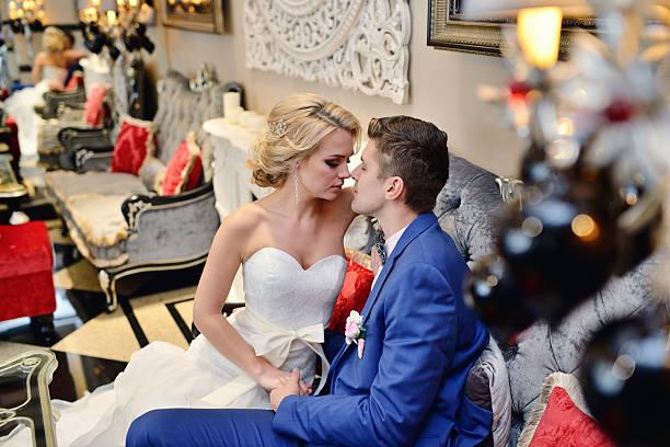 Wedding couple indoors is hugging each other stock photo