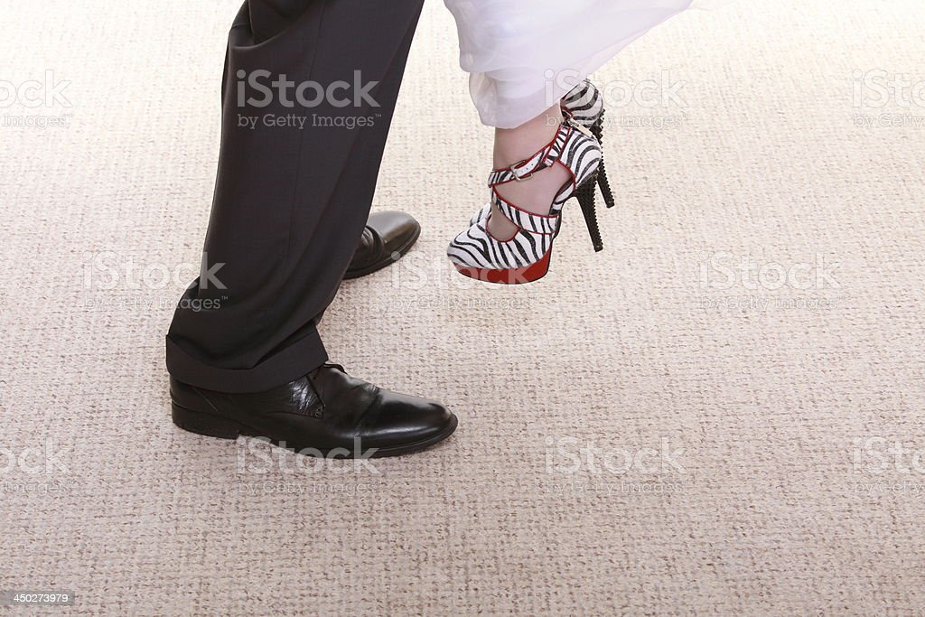 Wedding couple. Legs of the groom and bride. royalty-free stock photo