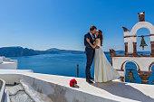 Wedding couple  on the background   island Santorini
