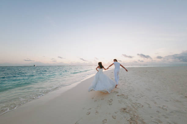 Wedding couple on the beach on the island stock photo