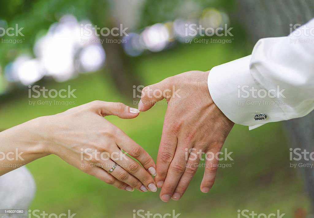 wedding couple showing shape of heart from their hands royalty-free stock photo