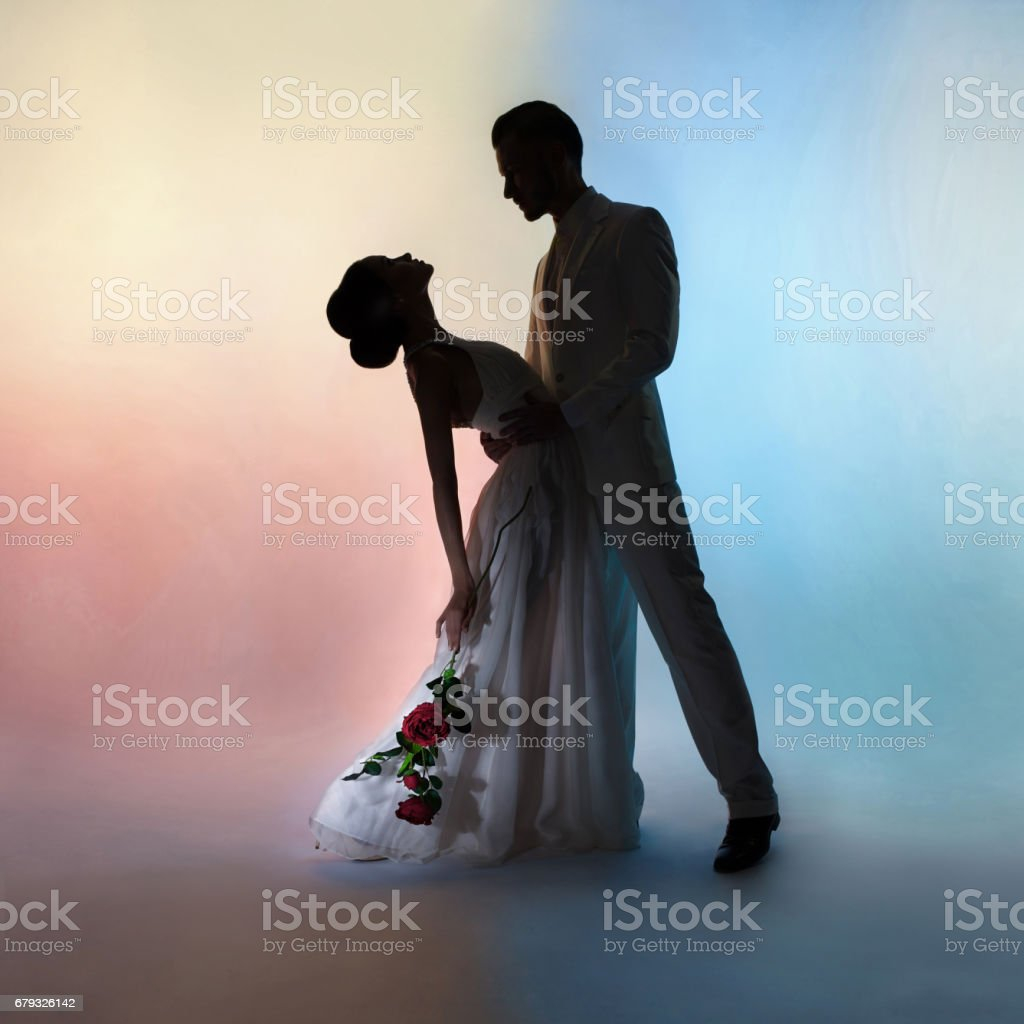 wedding couple silhouette groom and bride on colors background. Art Wedding style. royalty-free stock photo