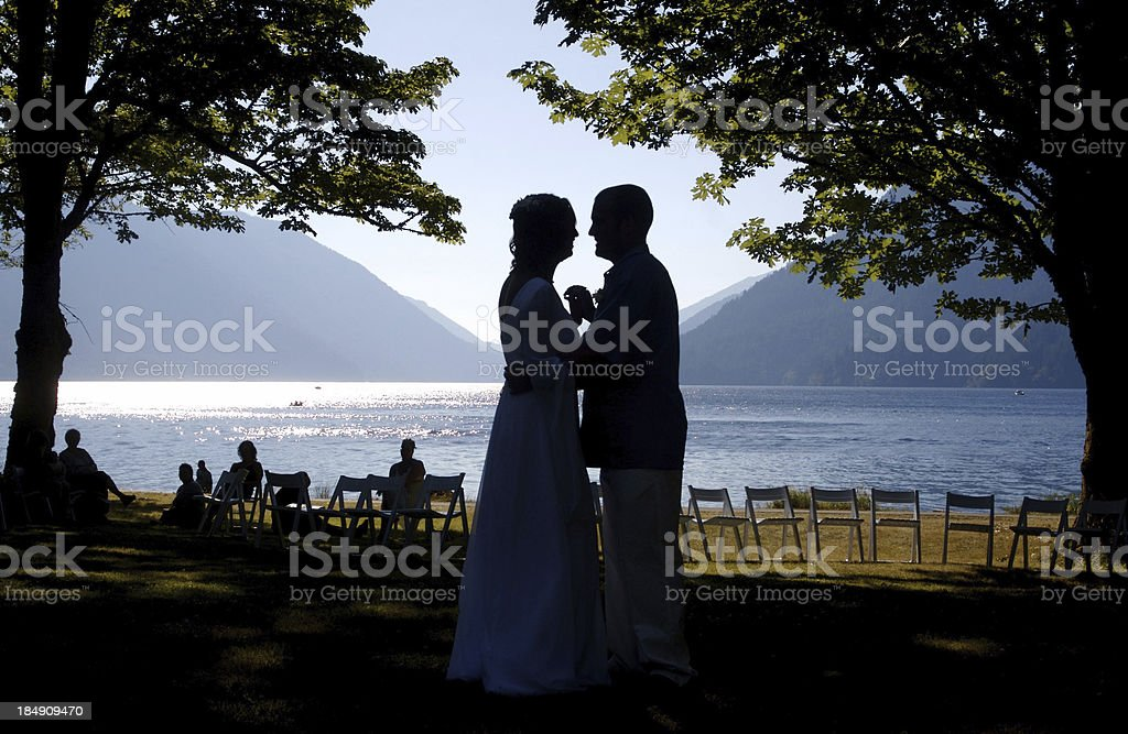 Wedding Couple's First Dance by the Lake royalty-free stock photo