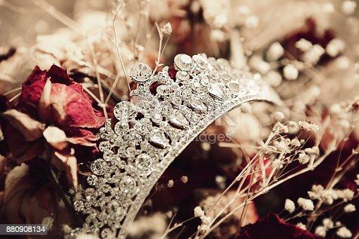 istock Wedding Crown on flower background 880908134