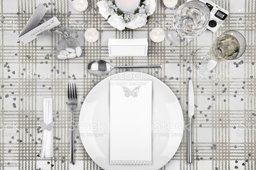 wedding day dinner table setting with a blank menu and name card stock photo