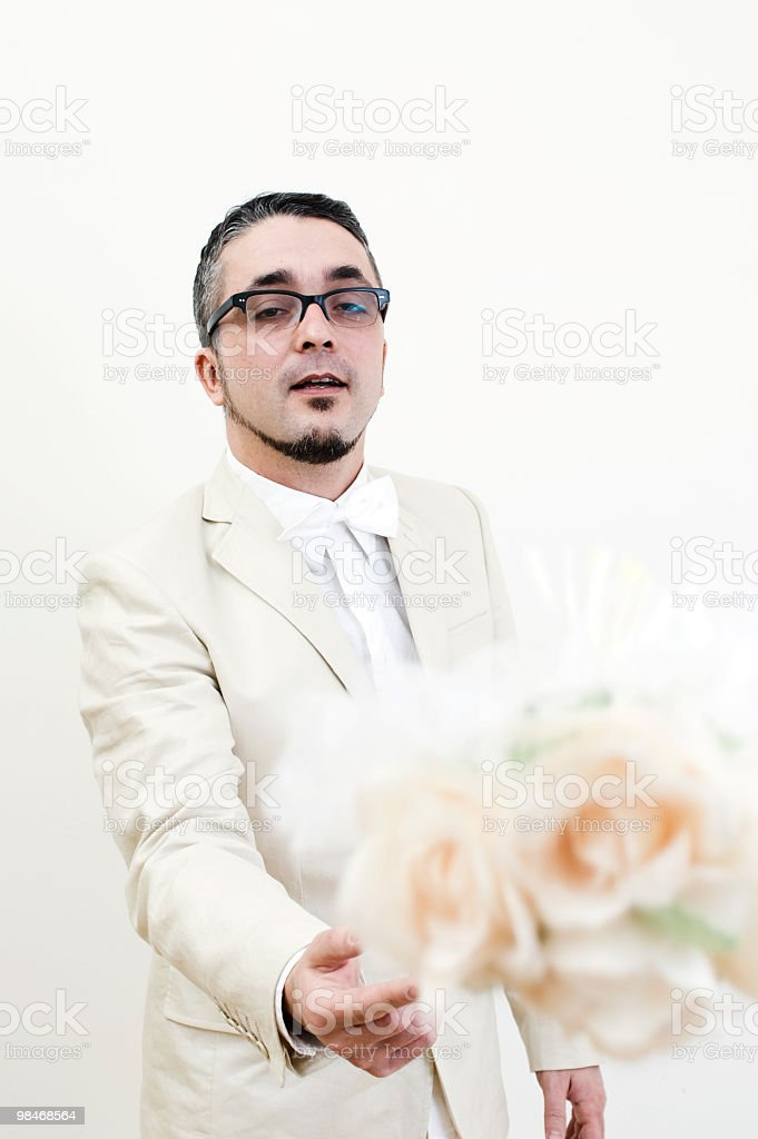 Wedding day: groom in beige royalty-free stock photo