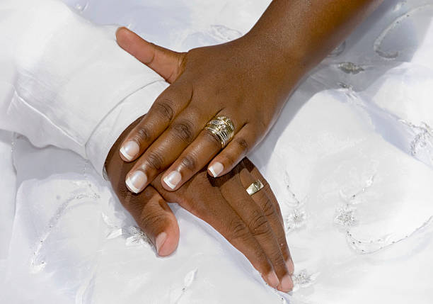 wedding day hands stock photo - African Wedding Rings