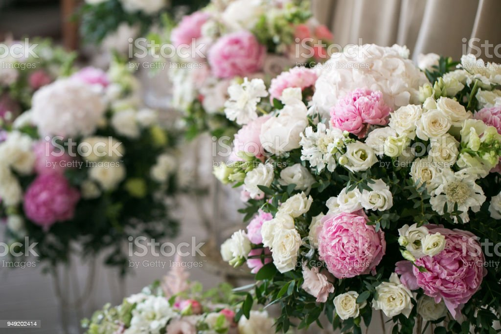 Wedding decor. beautiful flower compositions of fresh flowers. concept of a festive dinner, outdoor. rustic style terrace stock photo