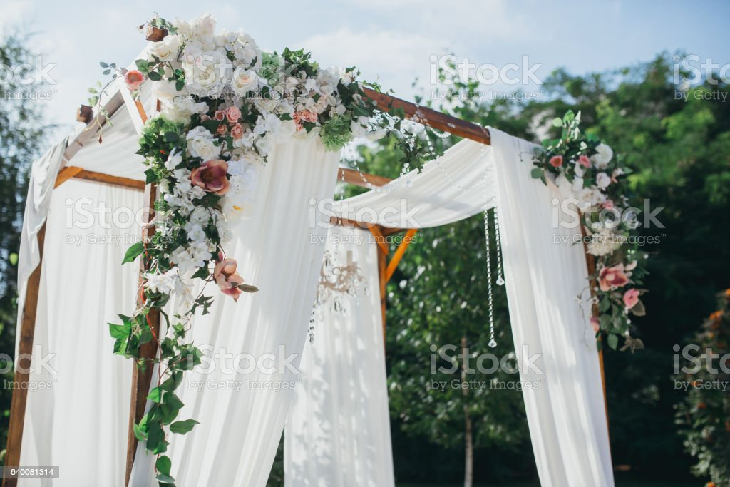 Wedding decoration ceremony chandelier in the arch of flowers stock wedding decoration ceremony chandelier in the arch of flowers royalty free stock photo junglespirit Images