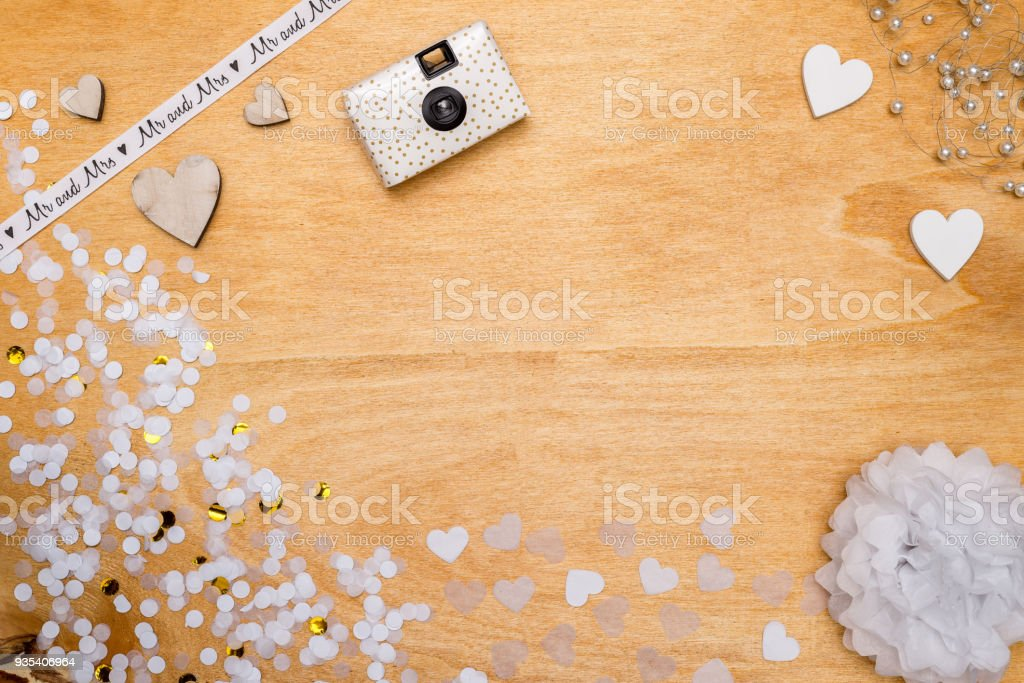 Wedding decoration for party with confetti, pearls and hearts from above stock photo