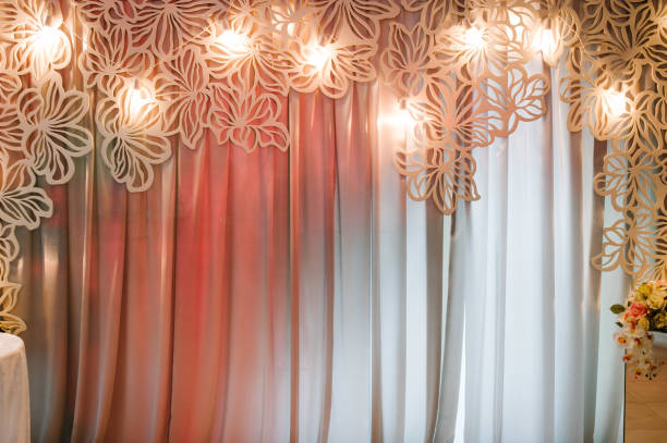 Wedding decorations in luxury ceremony. Arch with hanging garland of light bulbs at evening ceremony, copy space.