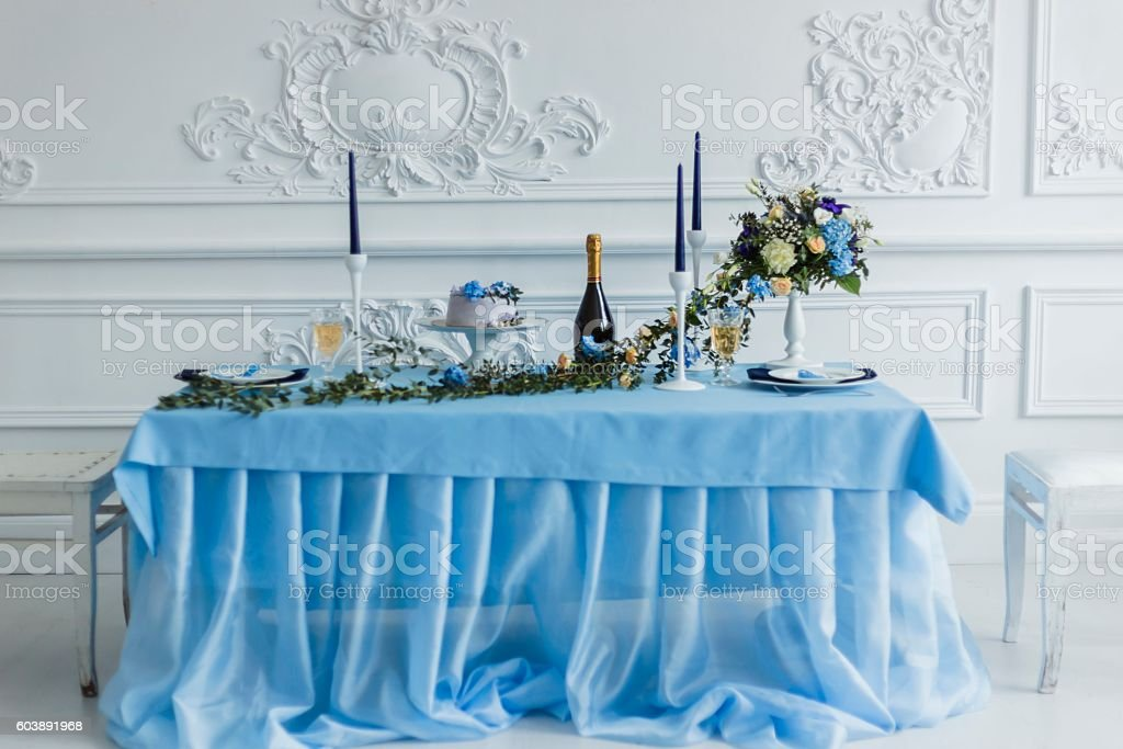 Wedding decorations with candles, cake and beautiful flowers stock photo